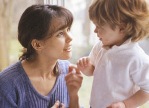 Mother Talking to Young Son --- Image by © Steve Prezant/CORBIS